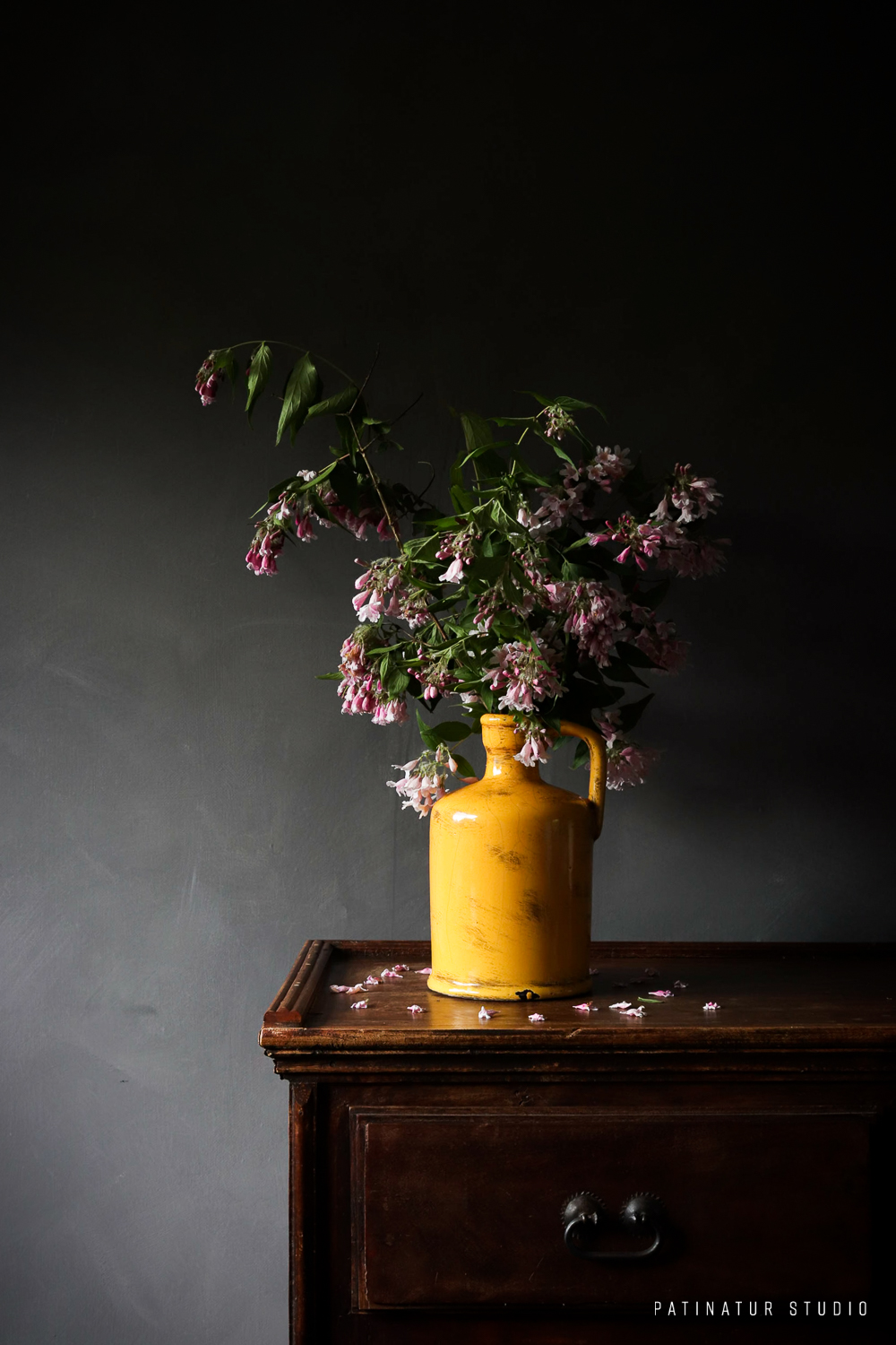 Photo art | Dark and moody still life with beauty bush bouquet in yellow vase