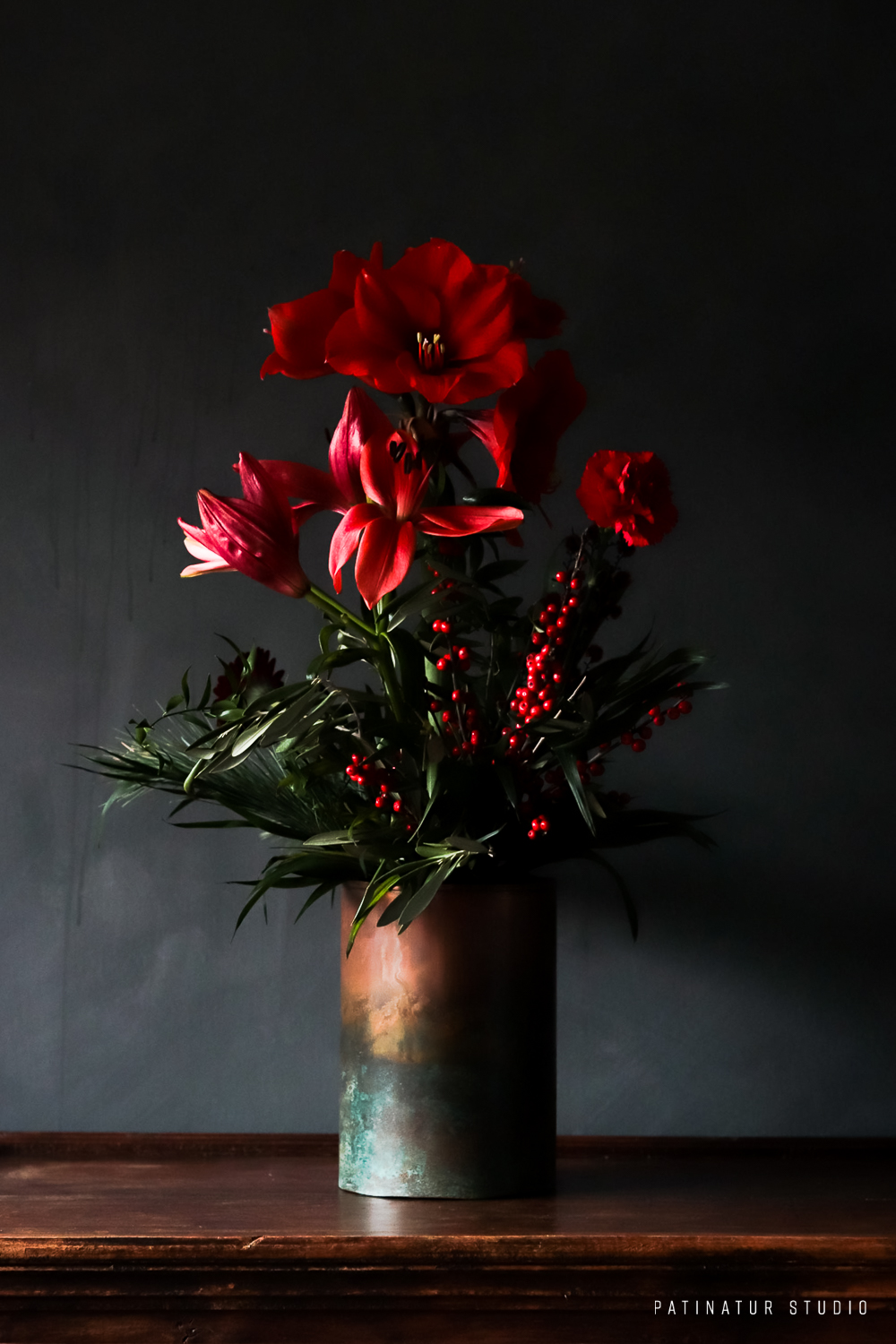 Photo art | Dark and moody still life with red Christmas bouquet in rustic copper vase