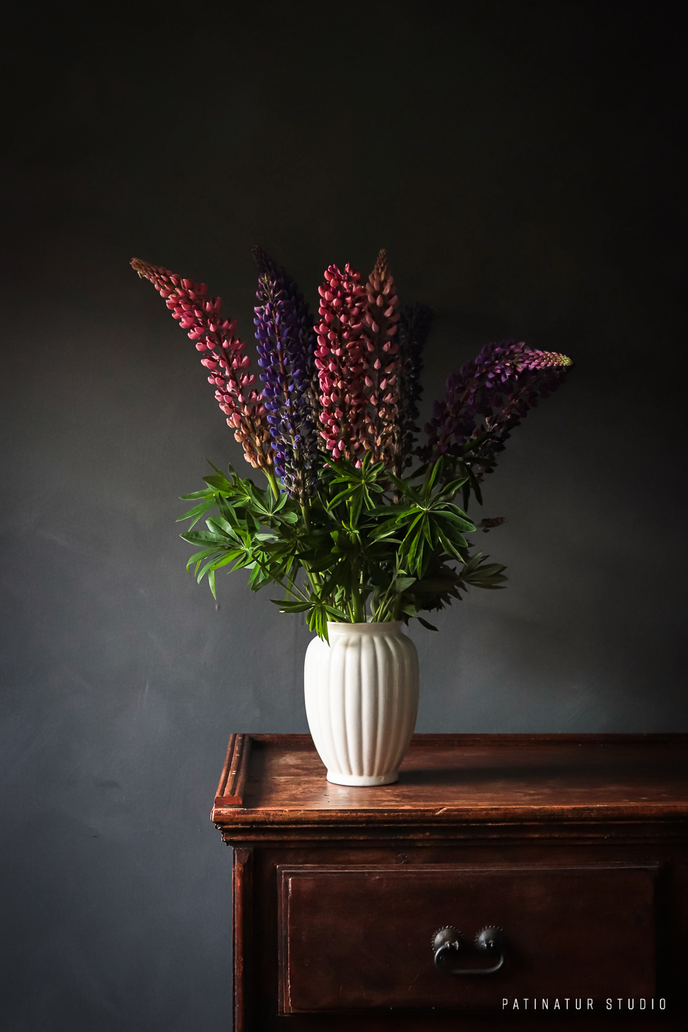 Photo art | Dark and moody still life with pink and purple lupins