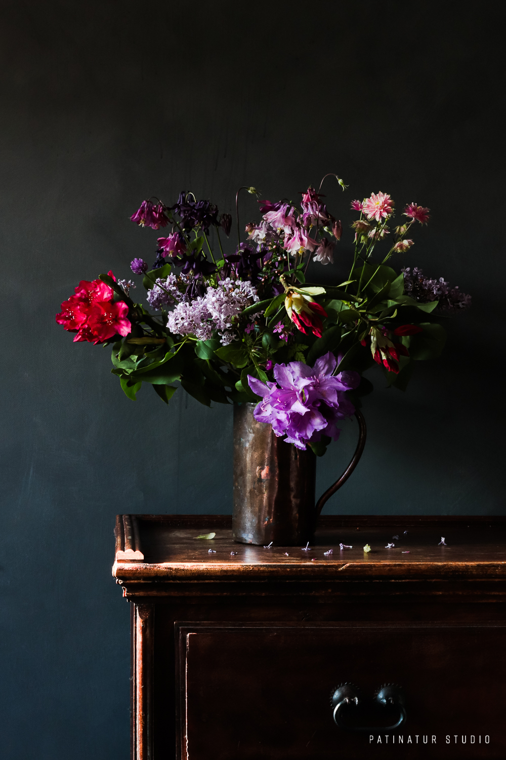 Photo art | Dark and moody still life with flower bouquet with Rhododendron, Lilac and Aquilegia in copper jug
