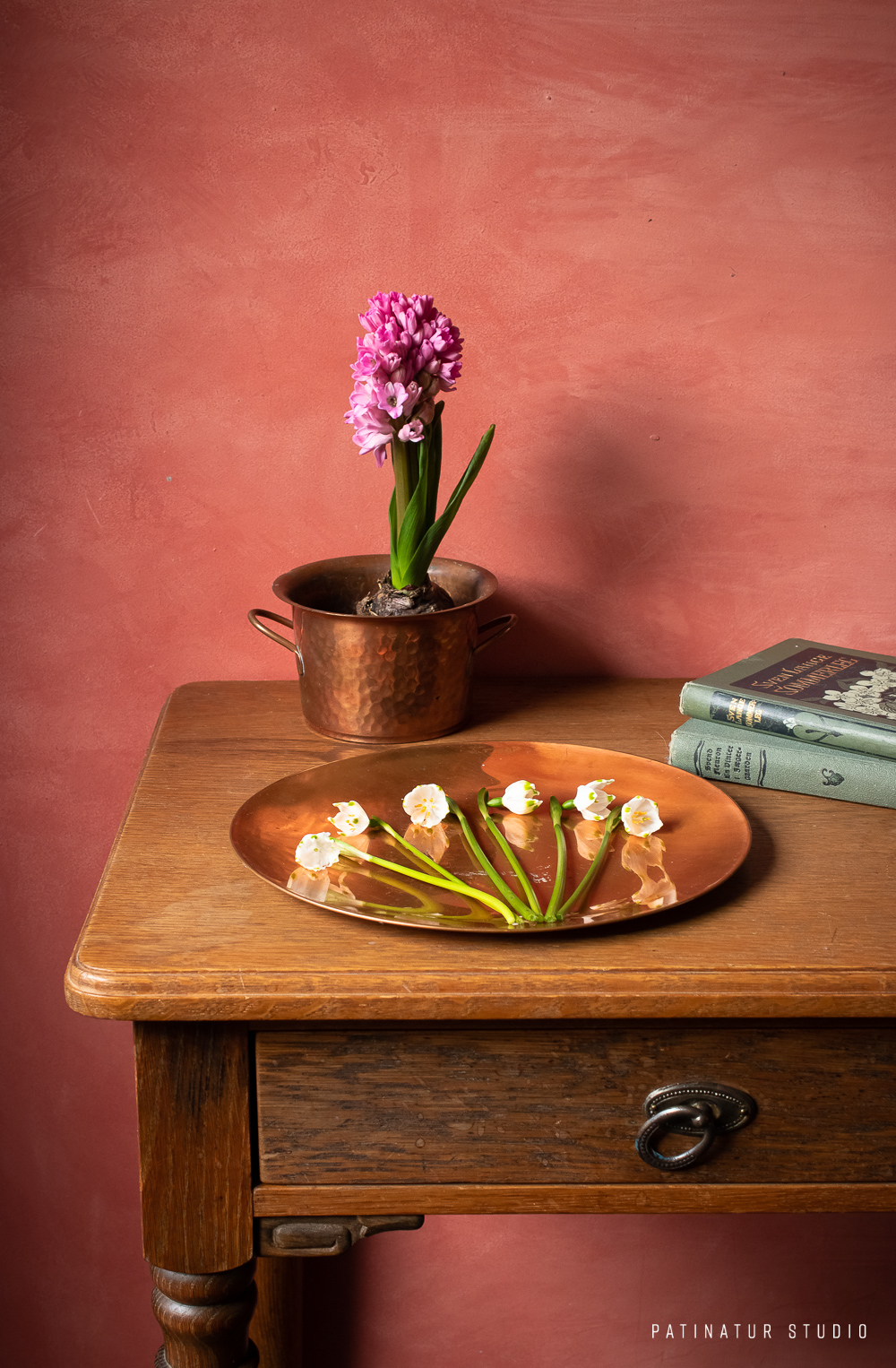 Still life photo with spring snowflakes, hyacinth and vintage books