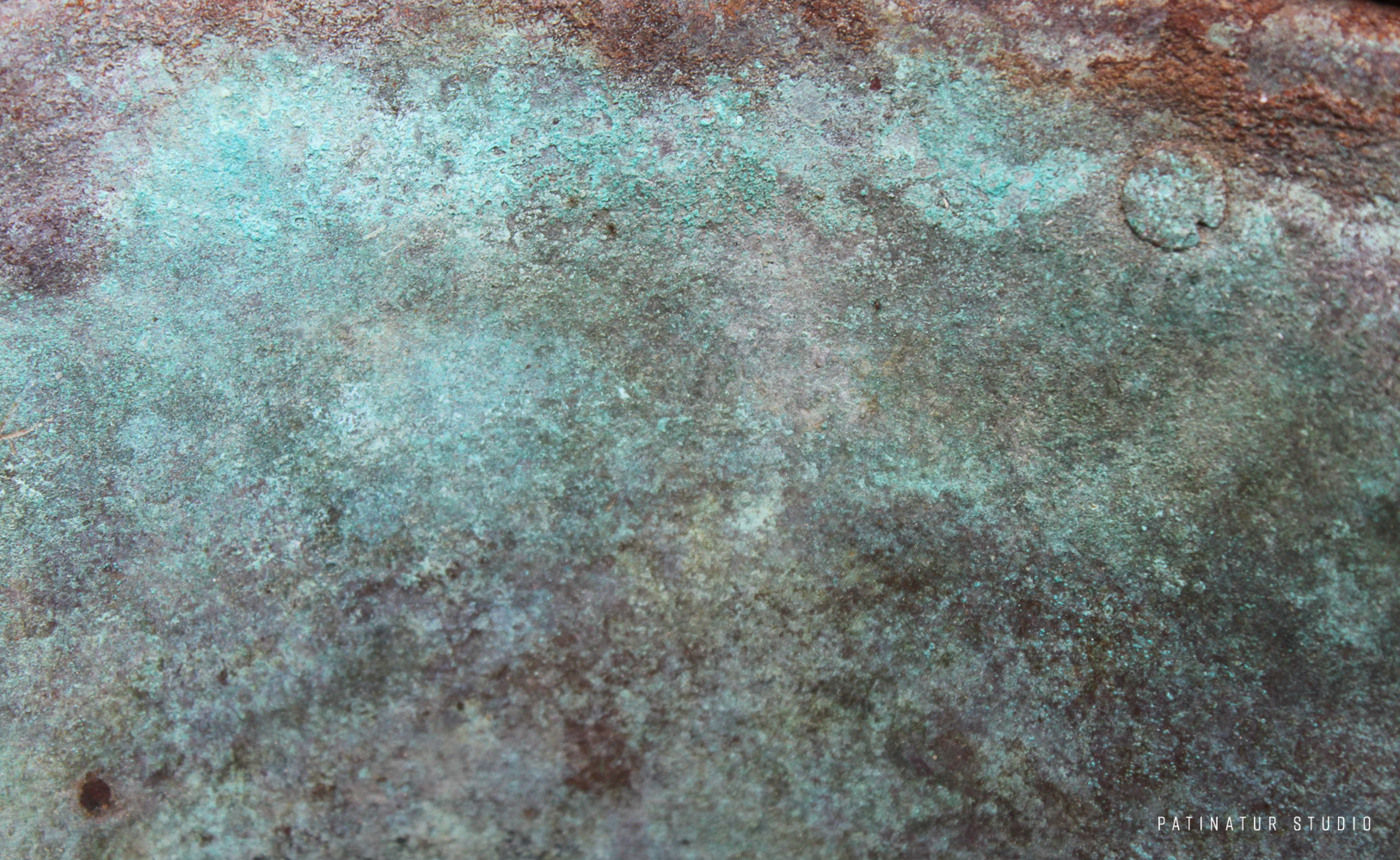 Photo art | Abstract close-up of green verdigris on an old pot.