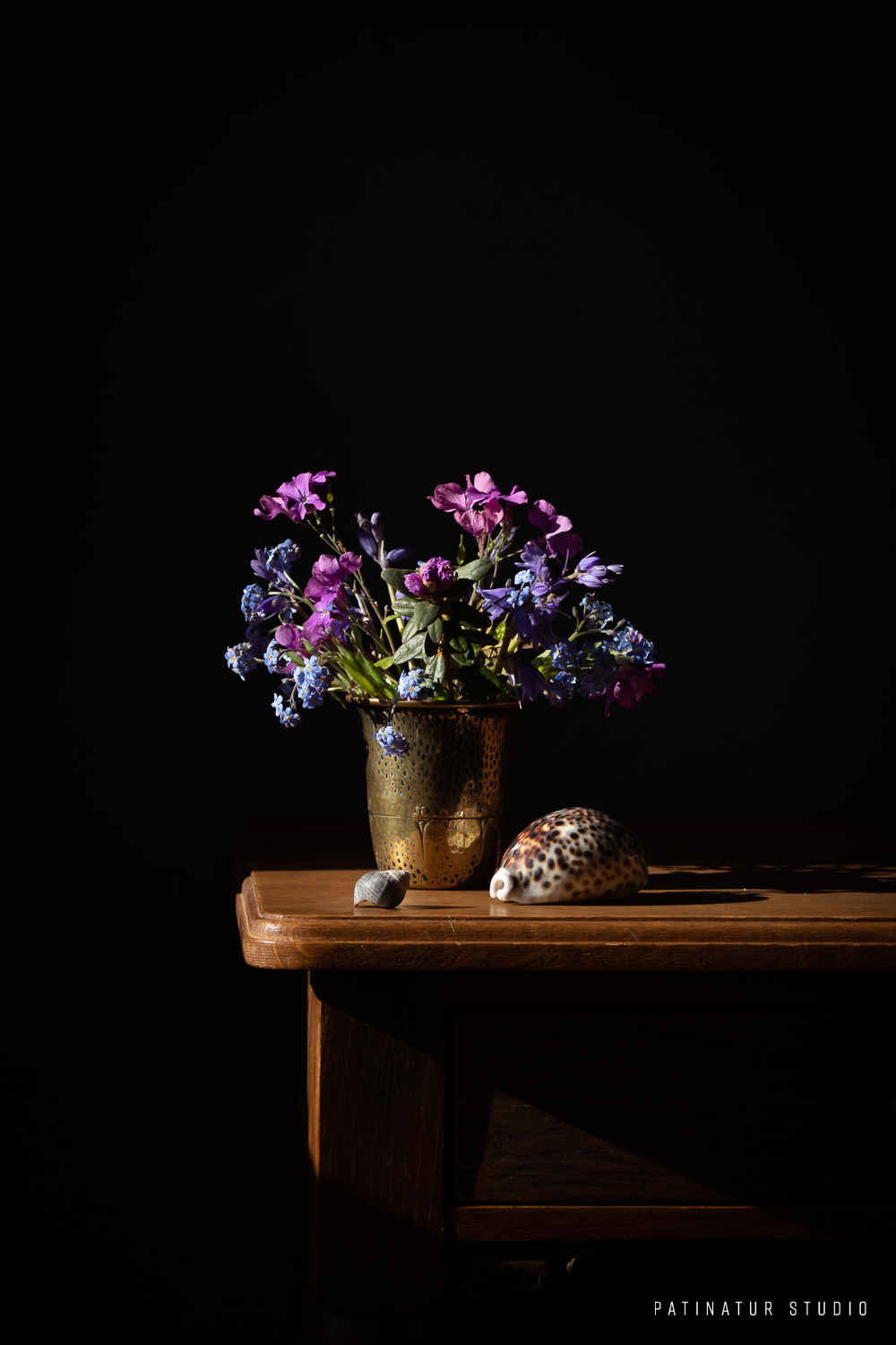 Photo art | Dark and moody still life with blue spring bouquet and sea shells