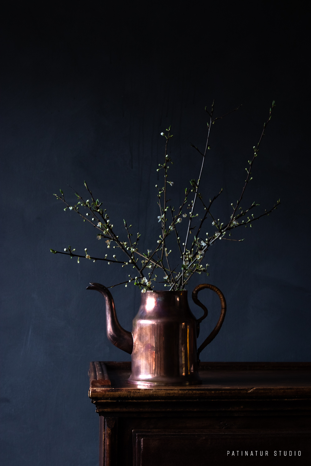 Photo art | Dark and moody still life with mirabelle blossom buds in copper jug