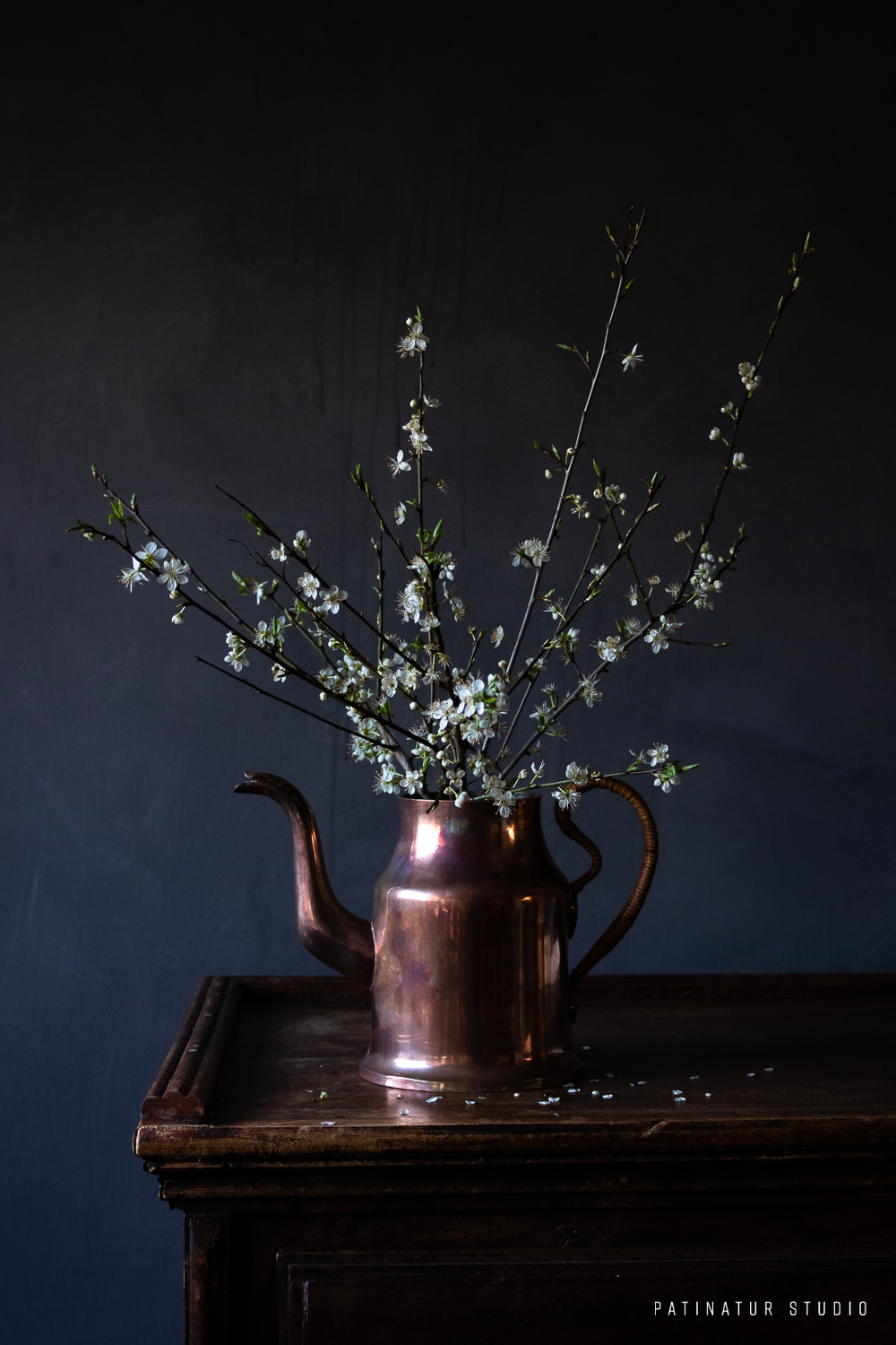 Photo art | Dark and moody still life with mirabelle blossoms in copper jug